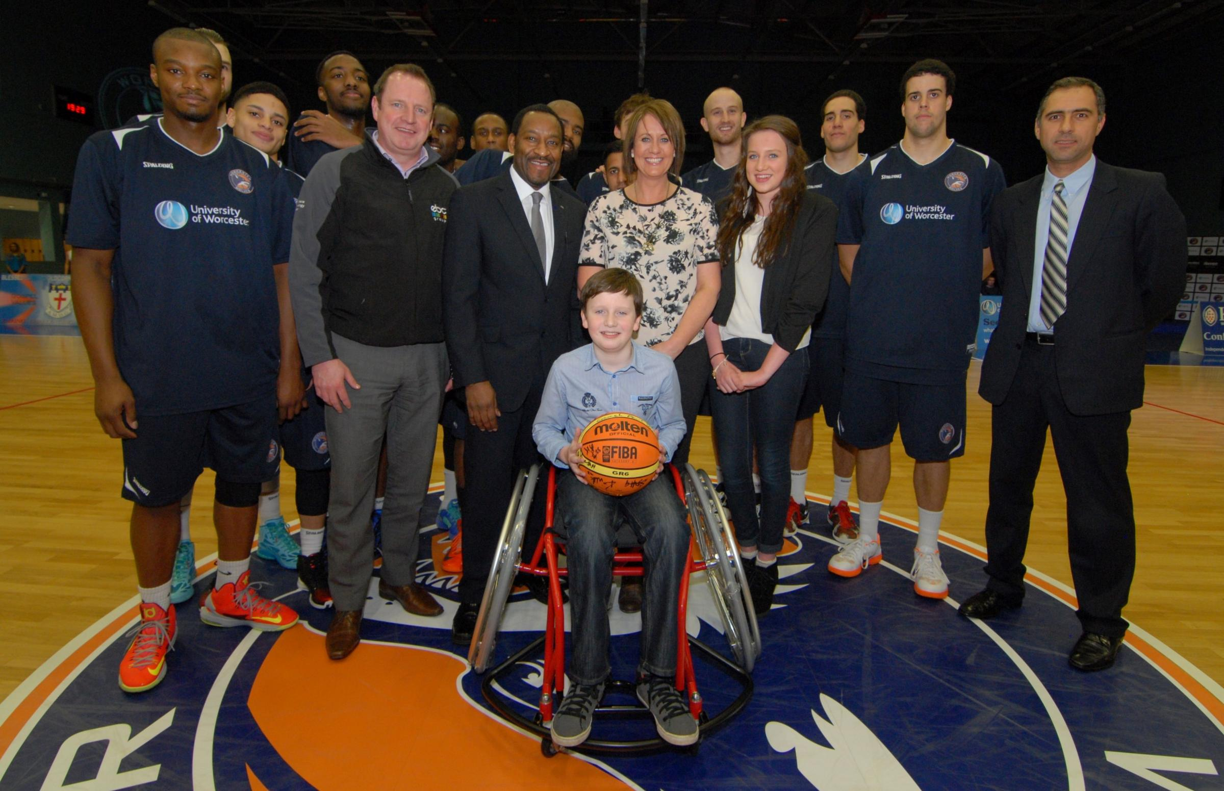 0914532301. 28/02/14. Henry Bowers aged 11 who has the rare degenerative condition Freidriech's Ataxia is presented with his Multisport wheelchair by Worcester Wolves head coach Paul James before the Wolves' British Basketball League match against