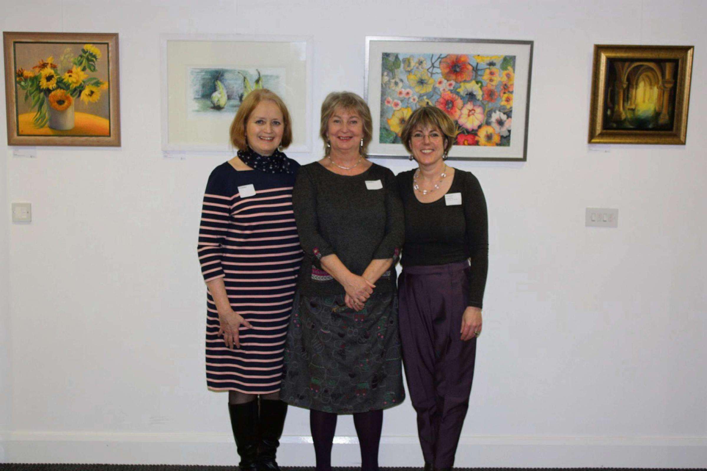 A Picture for Health trustees Nicola Currie and Sally Morgan with founder and trustee Dr Maggie Keeble at the exhibition at the Barbourne Health Centre
