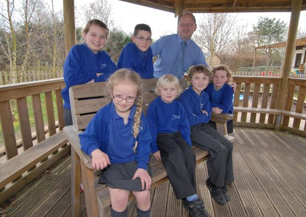 Back row, left to right - Rushwick CE Primary School pupils Ella Dee aged 10 , Jacob Mather 11 and headteacher Geoff Jeffrey with front, left to right, Charlotte Metcalfe, five, Harry Herbert, five, Oliver Humphrey, nine, and Cerys Thomas, eight inside th