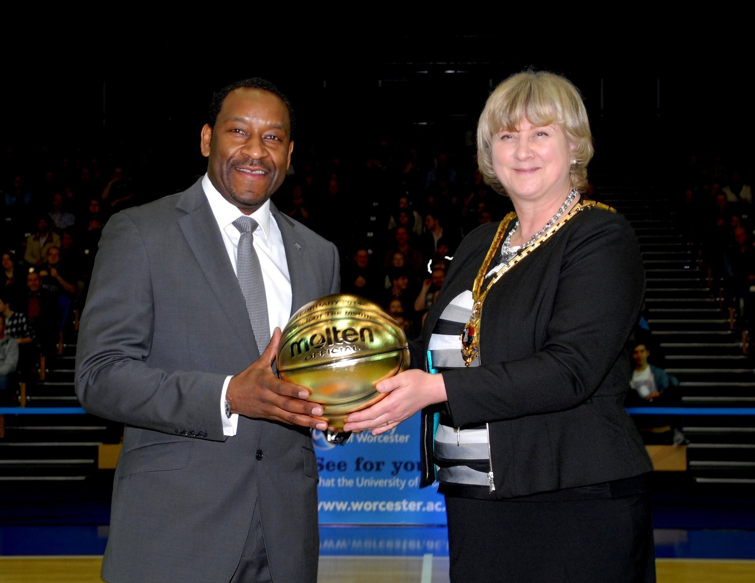 1114543401 Paul Jackson 12.03.14 Worcester BBL Trophy Semi-final second leg, Worcester Arena. Paul James, head coach is presented with the coach of the month trophy by mayor of Worcester Pat Agar. (4567855)