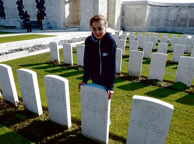 Year 9 Christopher Whitehead Language College student Olivia Charles stands beside the grave of her great, great grandfather Alfred Francis at Ypres