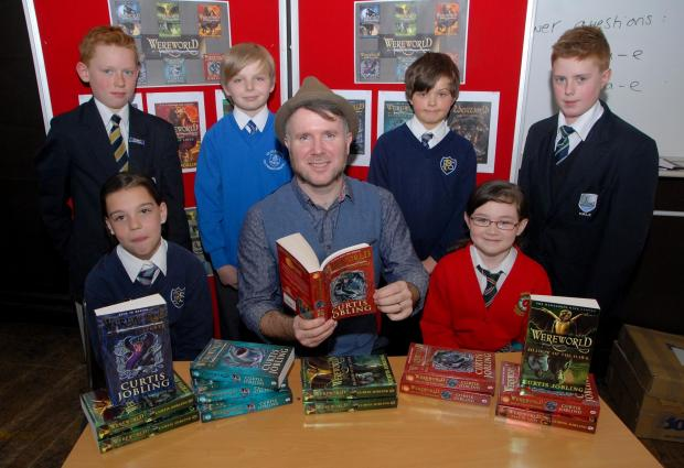 Author Curtis Jobling visits Christopher Whitehead Language College to talk to pupils and primary school pupils. Back from left - Ryan Arrowsmith, 12, Shane Woodman, 11, Jacob Beard, 11 and Trafford Freeman, 12. Front from left - Gina Smith, 11, Curtis Jo