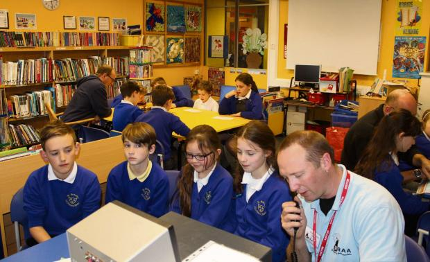 St Barnabas pupils CE Primary School pupils Brandon Worrall, Jack Faulkner, Rhianna Harris and Francesca Healey talk to radio enthusiasts from around the world
