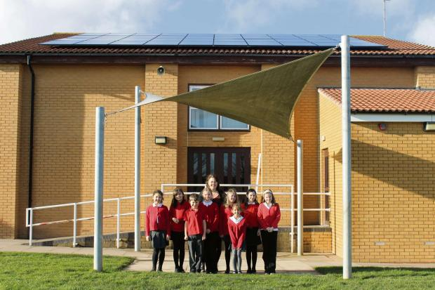 SOLAR POWER: Children from Whittington primary school have been monitoring their school's carbon emissions thanks to new solar panels.