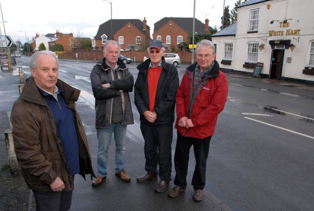 Worcester News: WORRIED: Fernhill Heath residents, from left - Bob Hollis, Steve Marshall, David Hope and Malcolm Sykes. Picture by Paul Jackson. 1314557202.