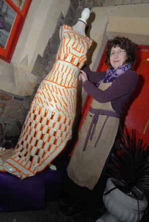 Dress to impress: Lucy Jones with her made of discarded train tickets