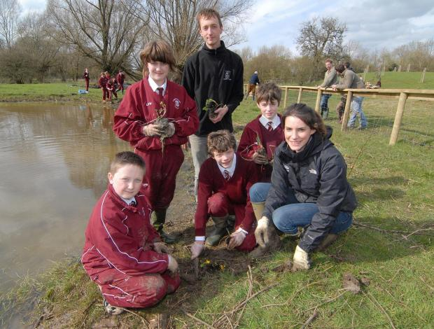 Worcester News: Rolling their sleeves up: Peter Case and Lucy Wood, Worcestershire Wildlife Trust wetland officers, with Bowbrook House School pupils George Waddington, aged 12, Lucy Hughes, aged 13, Matt Anning, aged 12, and Harry Broadley, aged 13, helping to restore w