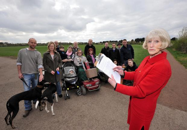 John Anyon        4/4/14       1414565101Drovers Way resident, Lesley Mettrick with her petition against  the development on Perdiswell playing fields, the proposed new site for Worcester City FC, by residents of the nearby Astwood Farm Estate (5162861)