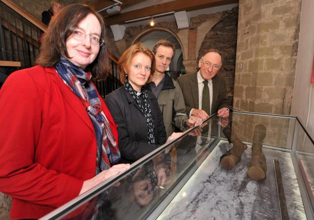 Worcester News: John Anyon        7/4/14      1514566501  The Worcester Pilgrim artefacts in their  new display case and part of a new interactive display in the Cathedral's Crypt...................Dr Dee Dyas from York University, Reverend Canon, Georgina Byrne, Mai