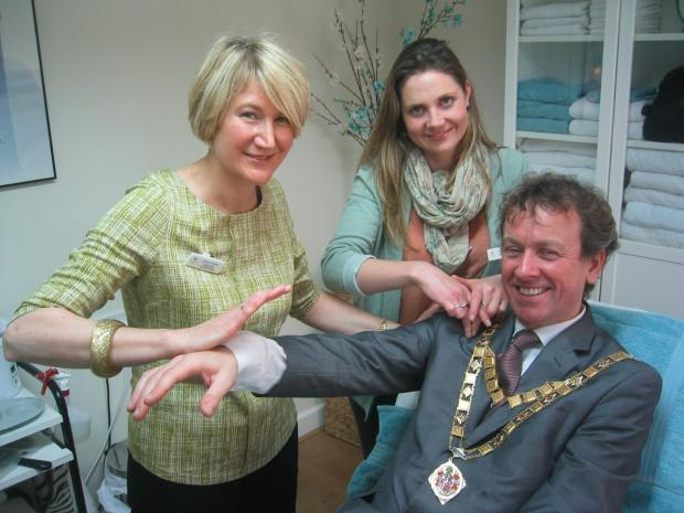 Worcester News: Mayor of Malvern Cllr Julian Roskams tries some of the therapies on offer at the new premises of the Centre for Wellbeing with kineseologist Allison Prebble (L) and co-owner Lindsay Holder (R).
