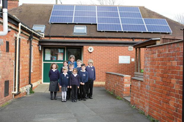 Pupils at Bretforton First School, with headteacher Ayse Moseley, are thrilled with the new solar panels.