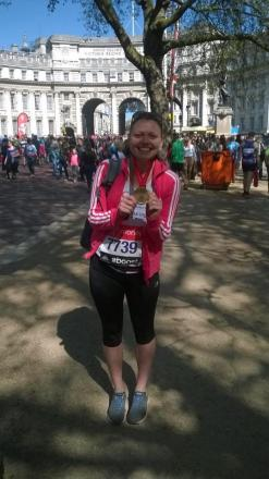 Sophie Booth in London after finishing the marathon on Sunday.