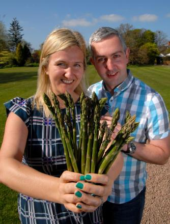 Anne-Marie Darroch and Paul Harley who will turn heads with Vale of Evesham asparagus in Anne-Marie's wedding bouquet.