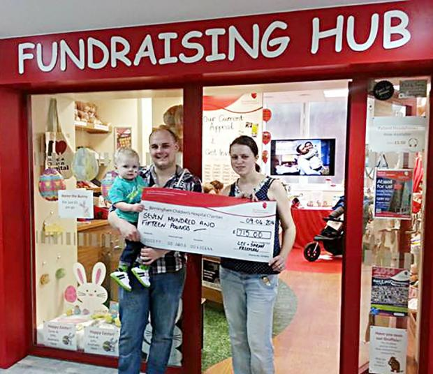 Lee and Sarah Freeman with baby Noah as they hand over more than £700 to Birmingham Children's Hospital thanks to generous donations form the good folk of Worcester.