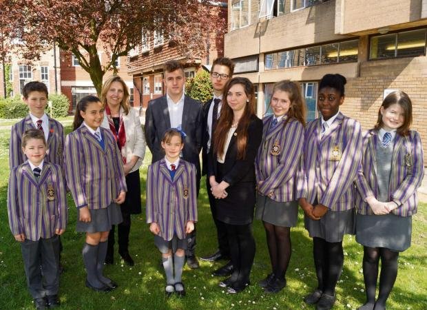Headteacher Pamela Leek-Wright with students from Holy Trinity International School, which will become a free school in September.