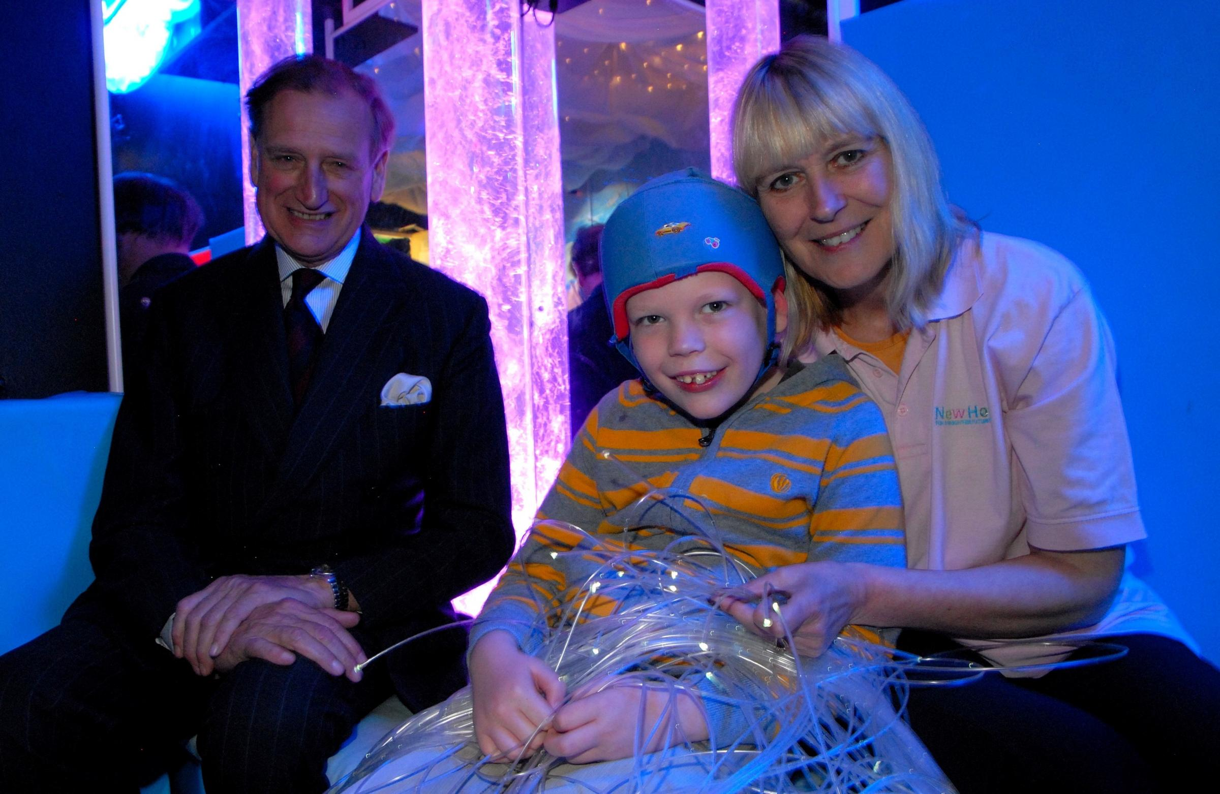 Worcester Lord Lieutenant Patrick Holcroft officially opens the new sensory room at New Hope with Finlay Morton, ten, and Jean Wilson, founder. Picture by Paul Jackson 1614573701