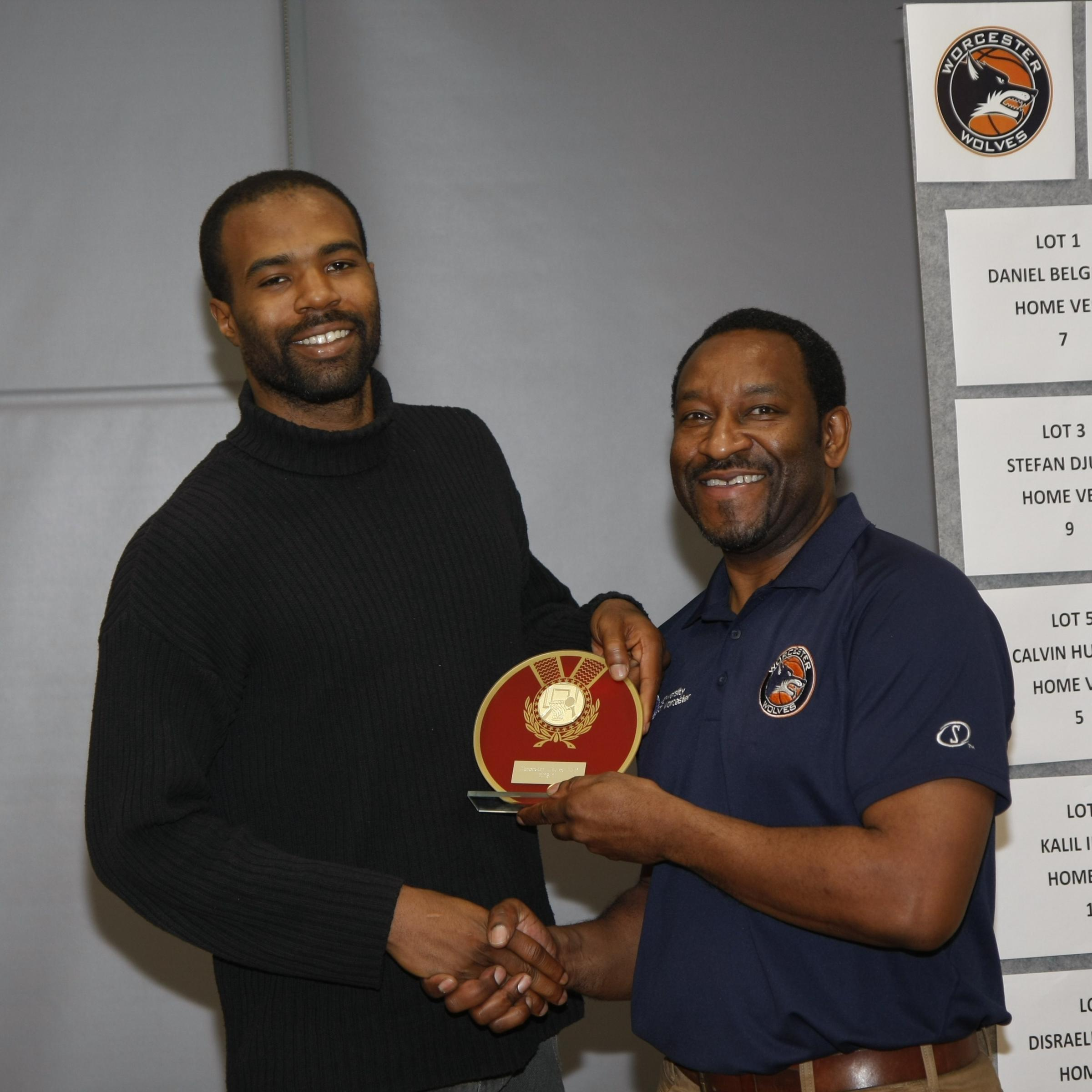 WINNER: Zaire Taylor (left) receives his most valuable player award from Worcester Wolves head coach Paul James.