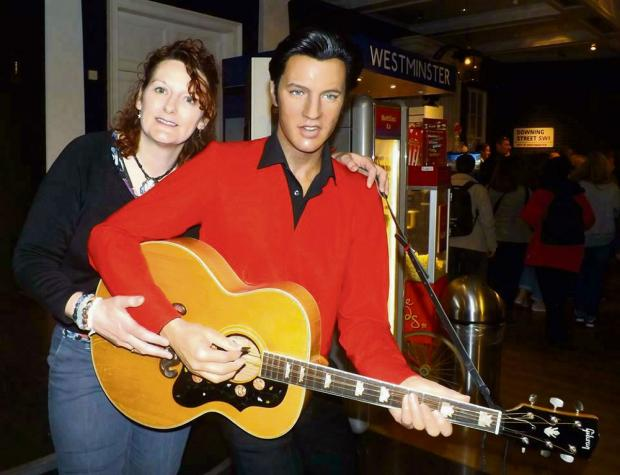 SHOOK UP: Karen Sutton with a model of Elvis Presley, whose teeth will be on show in her surgery