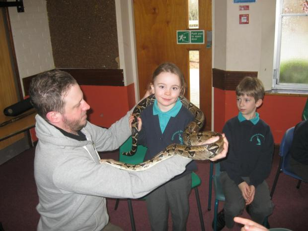 From left: Steffan Pearson aka The Animal Man, Hannah Philpotts, aged 7, and Thomas Simms, aged 7, both from year 2.