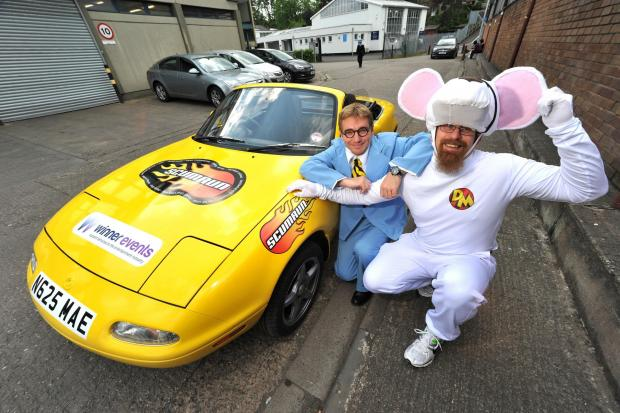 Worcester News: Nick Baldwin, dressed as Danger Mouse, and James Rose, dressed as sidekick Penfold, preparing for their 3000 mile charity car rally in an old Mazda car. pic Jonathan Barry 29.4.14 1814584101 (575