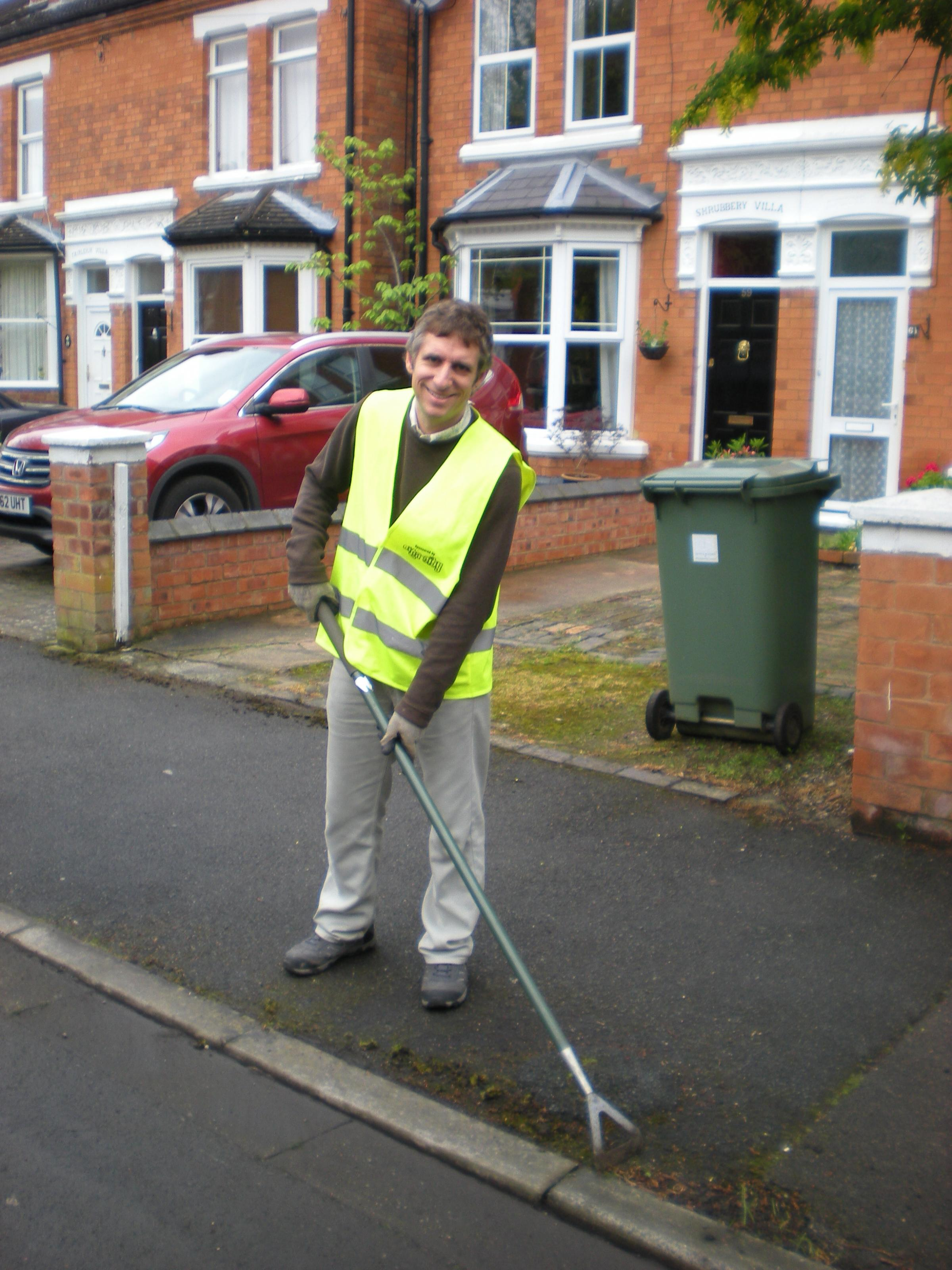 CLEAN UP: County councillor Matthew Jenkins helping to clean Shrubbery Avenue (s)