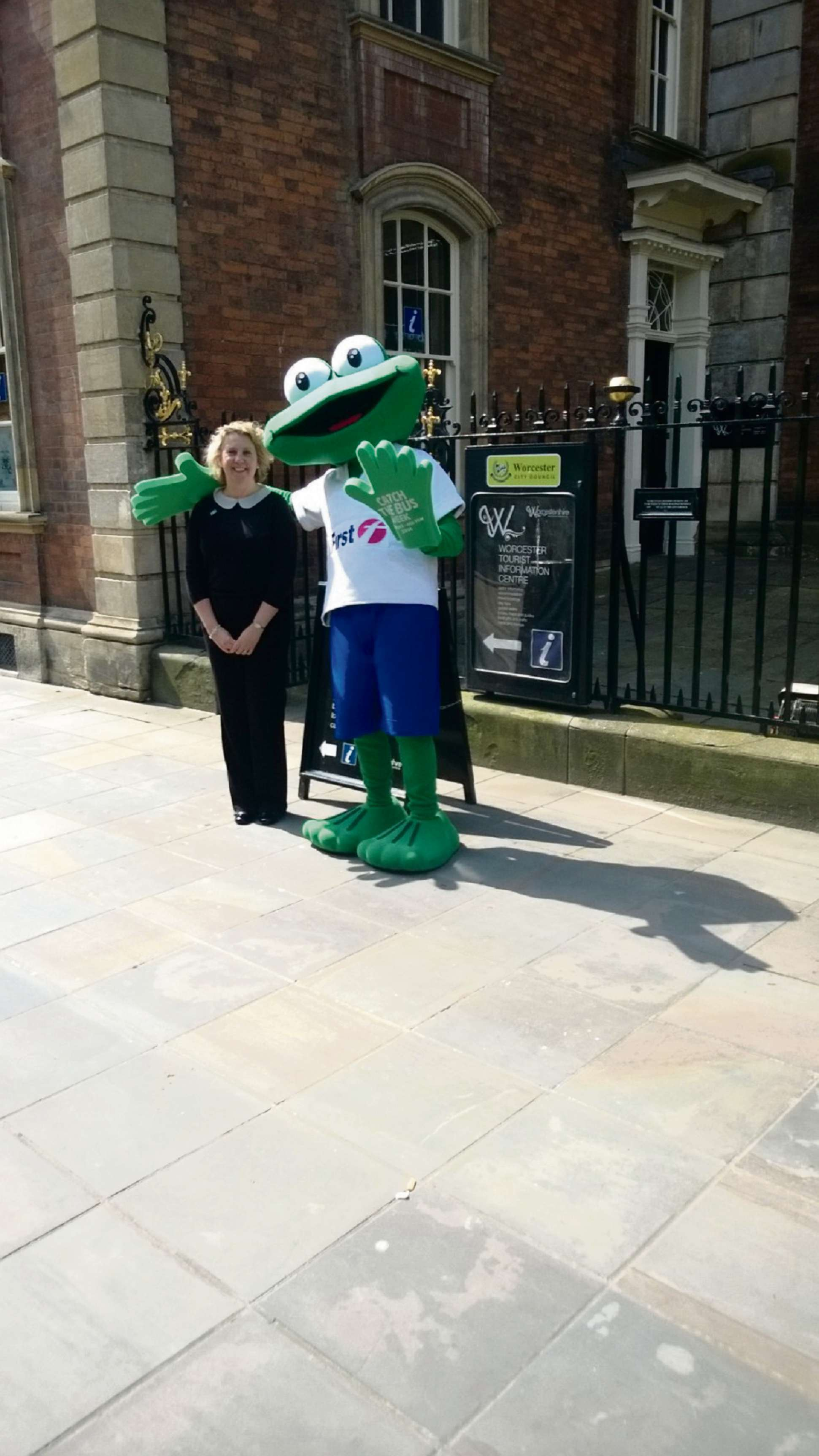 Worcester Tourist Information Centre manager Ruth Smith with First Bus official mascot Freddie the Frog