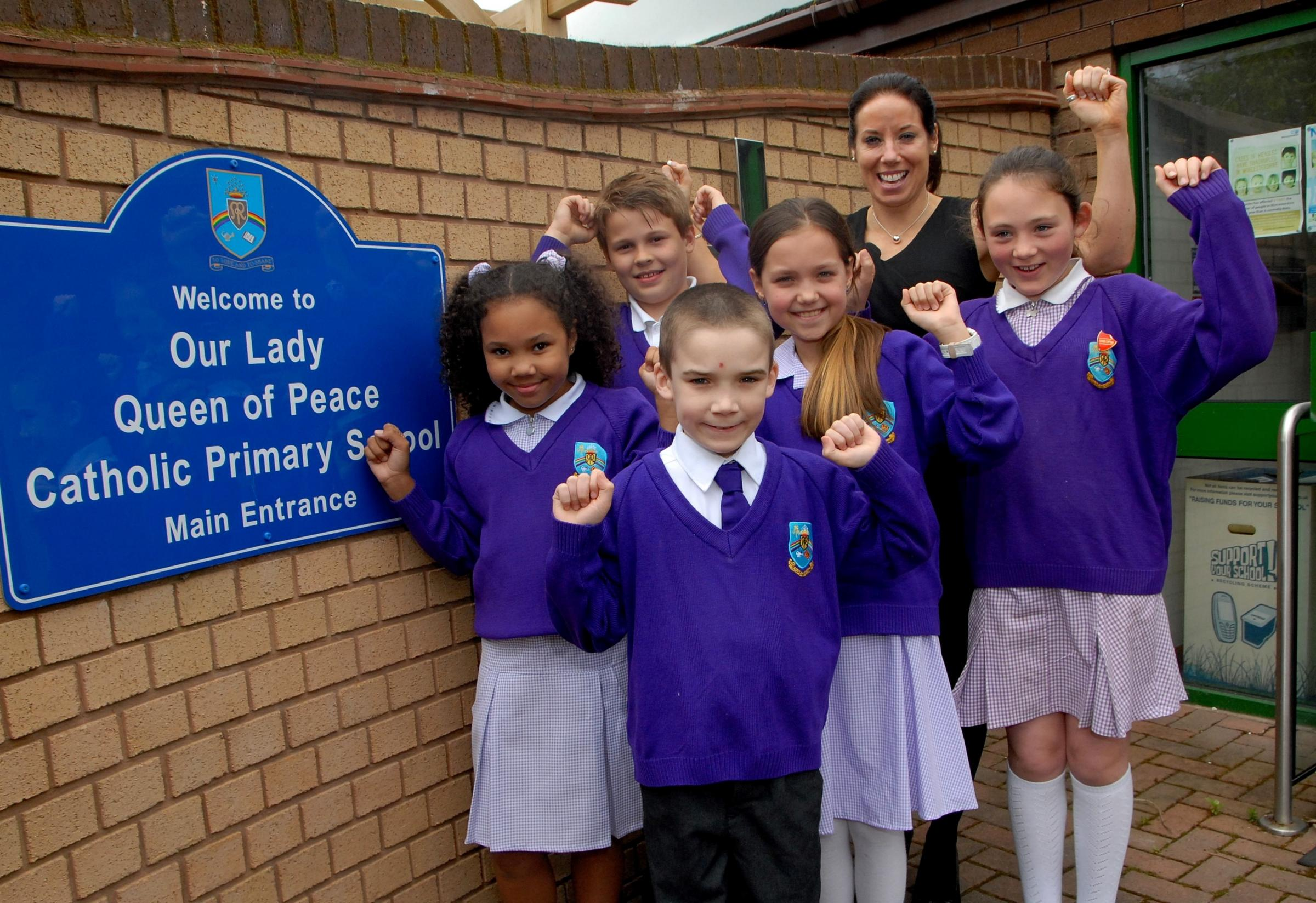 Our Lady Queen of Peace Catholic Primary College has received a good Ofsted report. Front - Lewis Fredricks, eight. Back from left - Darcy-Alexis Frater, eight, Jakub Wasilewski, 11, Veronique Glass, ten, Gwen Fennell, head teacher, Isobel Ward, 11. Pictu