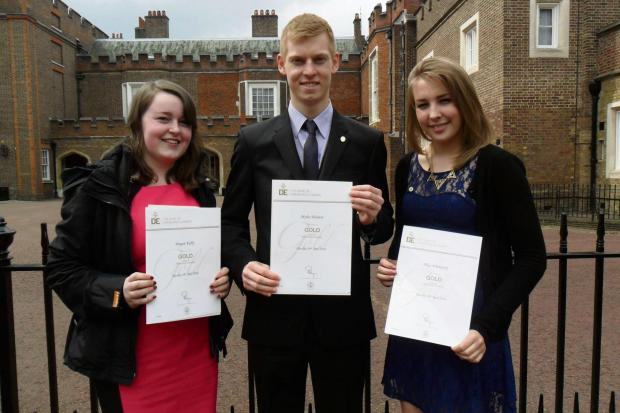 Megan Kelly, Miles Weaver and Alice Witherick were presented with their gold Duke of Edinburgh awards as St James's Palace.