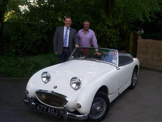 Charlie Richards of South Hereford Garage with Mark Atkins and his Austin Healey Frogeye Sprite.