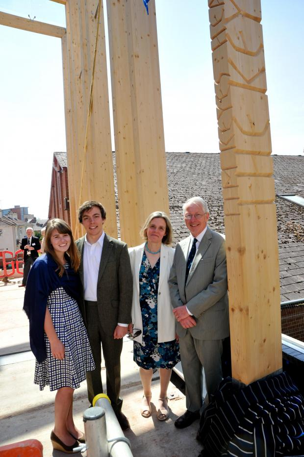 Worcester News: Retiring headmaster Tim Keyes with wife Mary Anne, son Sam and daughter-in-law Colette at the topping out ceremony.