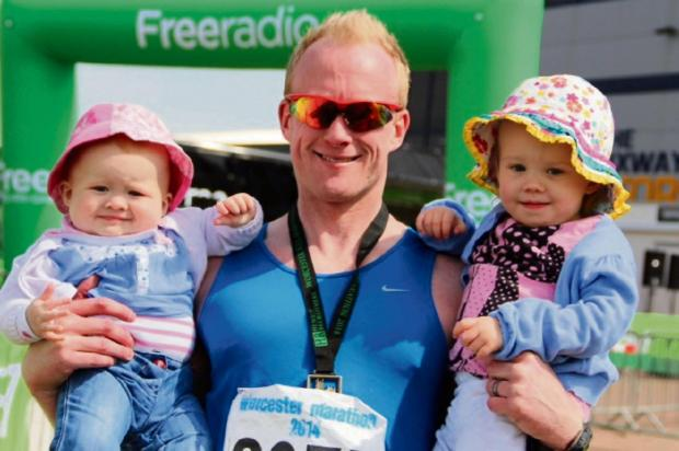 Worcester News: Graham Edwards with his daughters Mabel and Amelia