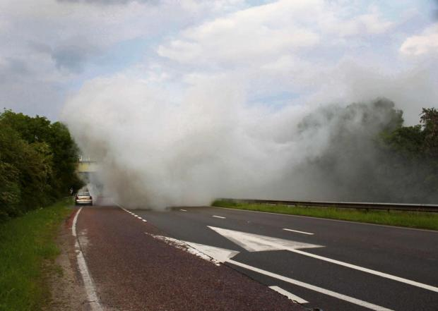 Worcester News: ROAD TO NOWHERE: The A449 near Blackpole blocked by clouds of thick white smoke, leaving cars with nowhere to go. Picture by Andy O'Hare.