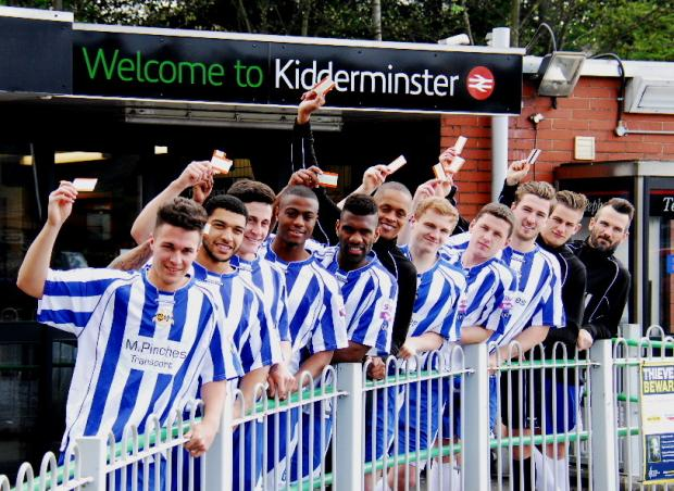 Worcester City players with train tickets outside Kidderminster station. Picture by Stephen Widdowson.