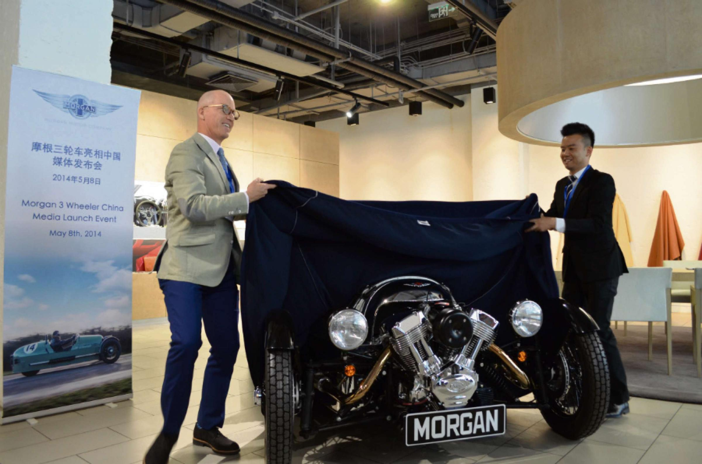 Jim James (left), managing director of Morgan Cars China, helping to unveil the first Morgan 3 Wheeler in China with Austin Li, sales and marketing manager of Morgan Cars China.