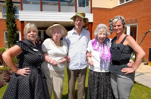 2114604301 Paul Jackson 21.05.14 Worcester Latrimer Court staff and residents dress up for National Dementia Awareness Week. From left - Bernie Simmonds, deputy manager, Joyce Bulmer, Godfrey Ash, Pat Snow and Karen Hancox, manager. (6427256)