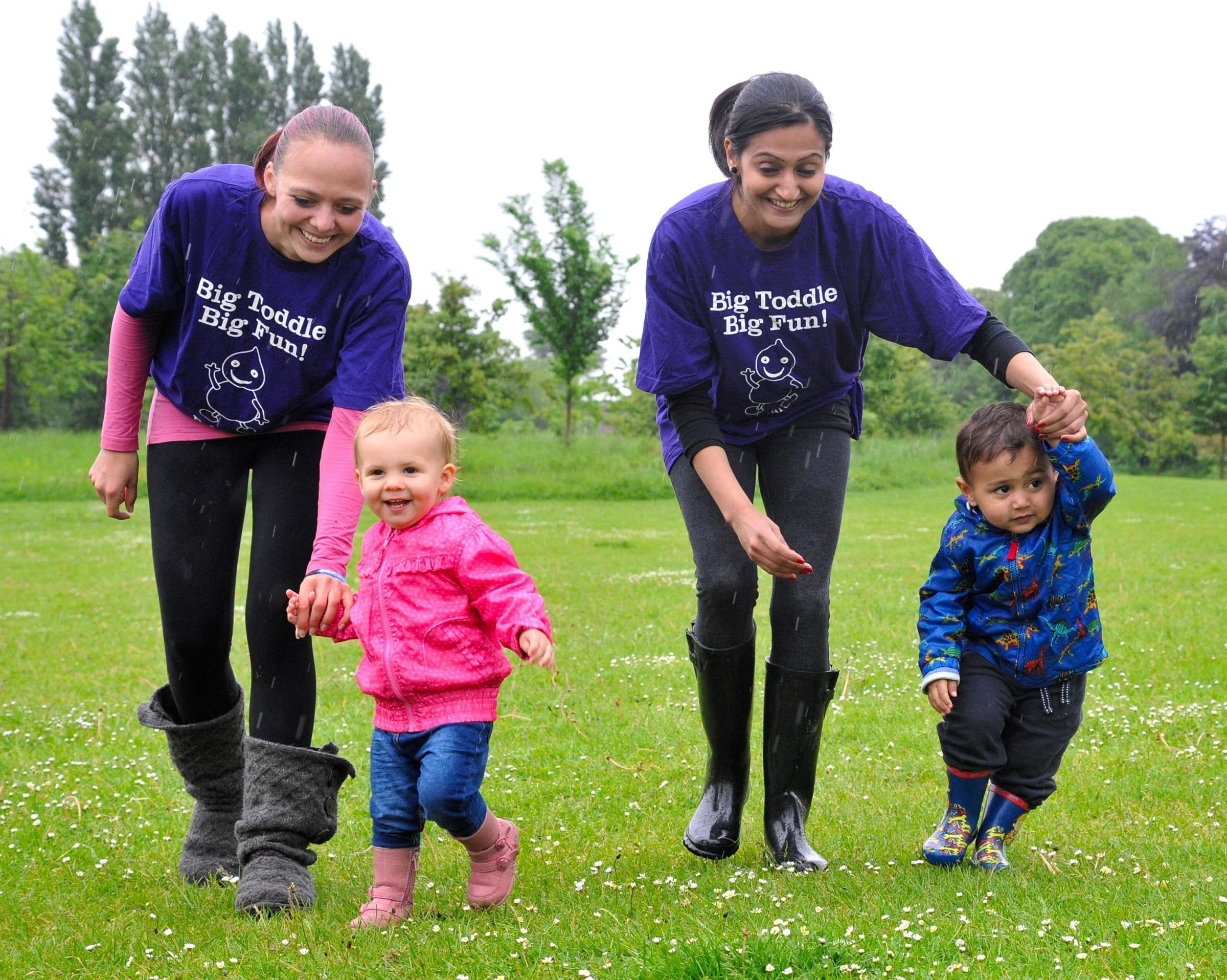 Tots toddle in the rain at children's charity event
