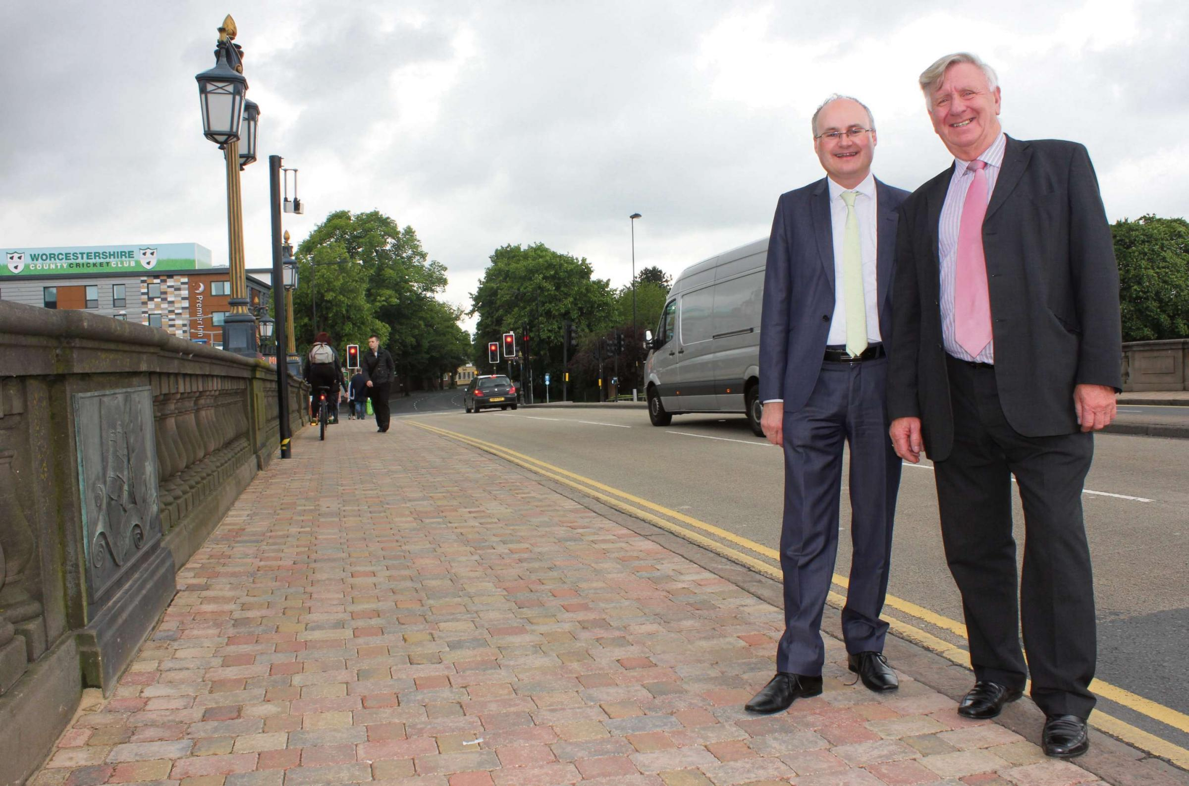 Cllr Simon Geraghty, county councillor for the Worcester Riverside division, and cllr John Smith, cabinet member for Highways, on the improved Worcester Bridge where work on an improvement project was completed ahead of schedule overnight May 29/30.