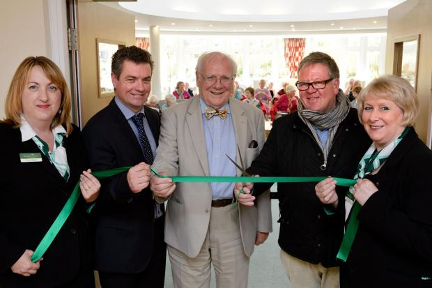 Philip Serrell cuts the ribbon with (from left) Fiona Rogers (McCarthy and Stone senior sales consultant), Tim Lightfoot (McCarthy and Stone construction director), Dr Barry Barber (Cartwright Court's first resident) and Carol Shone (McCarthy and Ston
