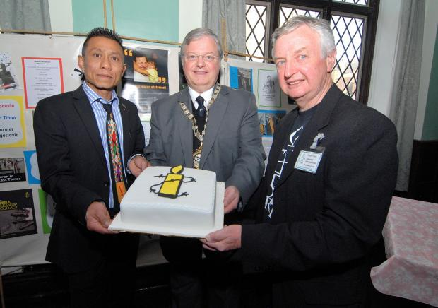 SPECIAL VISIT: Former Burmese prisoner of conscience turned human rights lawyer Ko Aung, Mayor of Worcester Alan Amos and member of the Worcester Group of Amnesty International Peter Yates at the groups' 40th anniversary celebration.