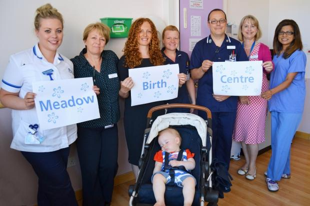 (L–R) Student midwife Gemma Parkes, ward clerk Tracey Linsey, Rachel Spencer, midwife Nick Vakis-Lowe, divisional director of nursing and midwifery Patti Paine and consultant obstetrician Rabia Imtiaz with baby Rupert Spencer (seated)
