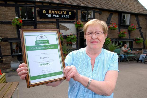 Worcester News: 2414622101 Paul Jackson 11.06.14 Worcester The Mug House has been awarded a certificate of excelence by Tripadvisor, Landlady Judy Allen. (7069116)
