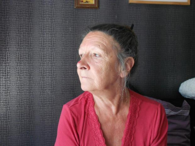 HOUNDED: Gina Harrison has been afraid to answer the door or the telephone. She suffered a second stroke two weeks ago.