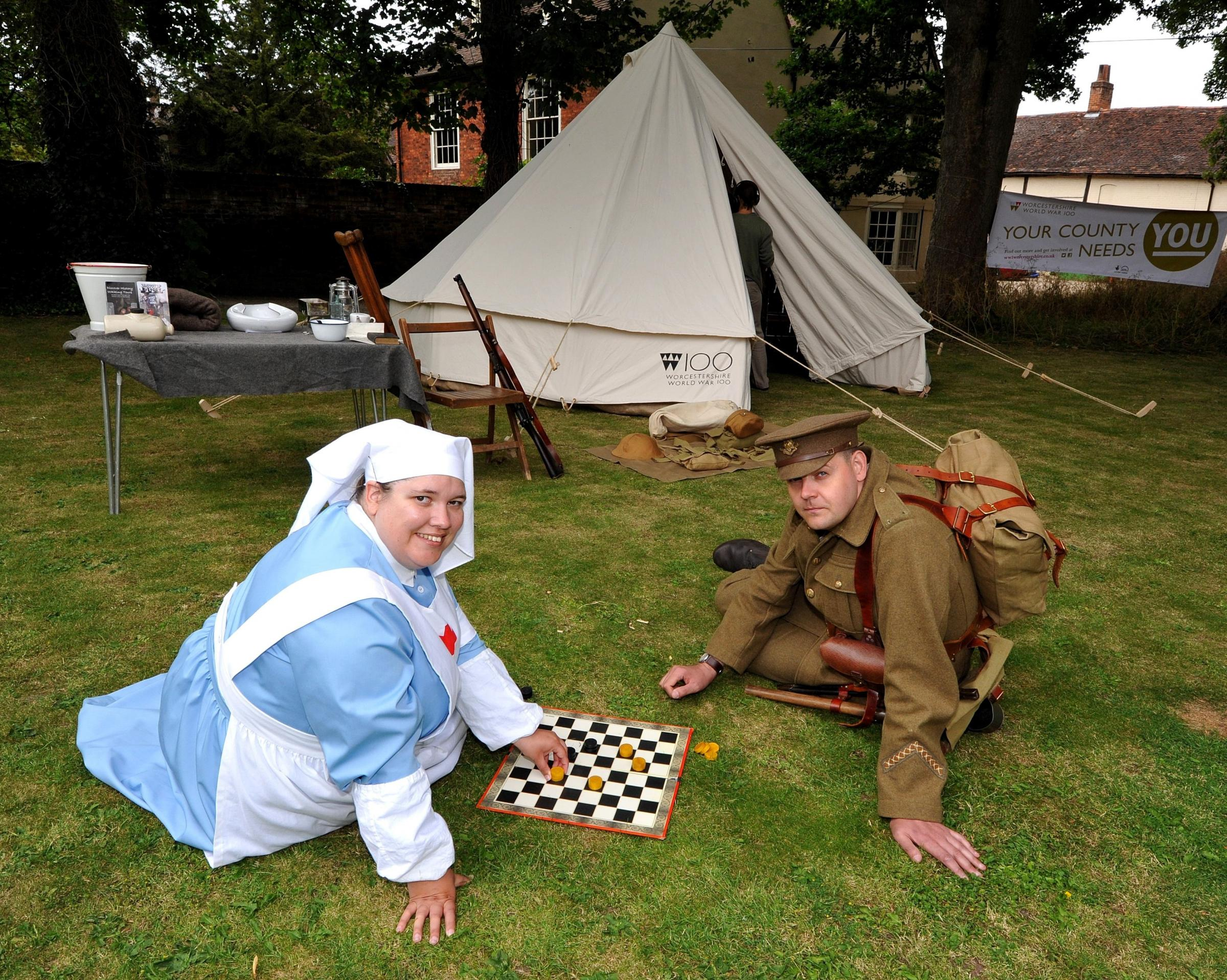 BELL TENT: First World War replica Bell Tent in the garden of The Commandery, Worcester, at a previous event in the Worcestershire World War One Hundred Project.VAD Nurse Helen Lee and Worcestershire Regiment soldier, Mark Harding play draughts. Pic by Jo