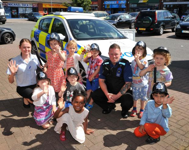 John Anyon      24/6/14        2614632601  Police car visit to Busy Bees Nursery in Warndon on Tuesday...........PCSO, David Anderson with Busy Bees Senior Room Manager, Sara Holloway and children with the police car (7469898)