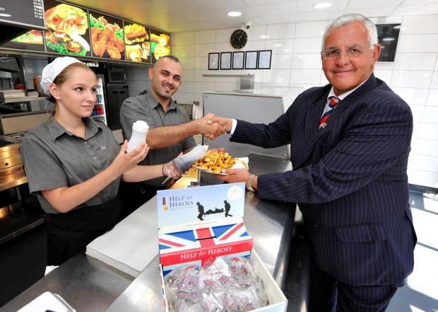 Worcester News: John Anyon         25/6/14        2614634701  Lowesmoor Fish Bar has raised £1000 for Help for Heroes by holding a half price day and donating the other half to the charity..............Owner, Hivan Khoodarahmy and assistant, Bilyana Yaneva with Hel