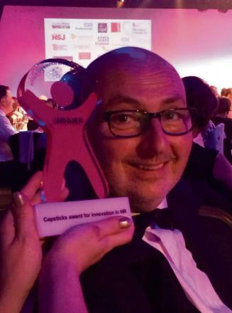 Rev David Southall with his innovation award at the Healthcare People Management Association Excellence in Human Resources Management Awards