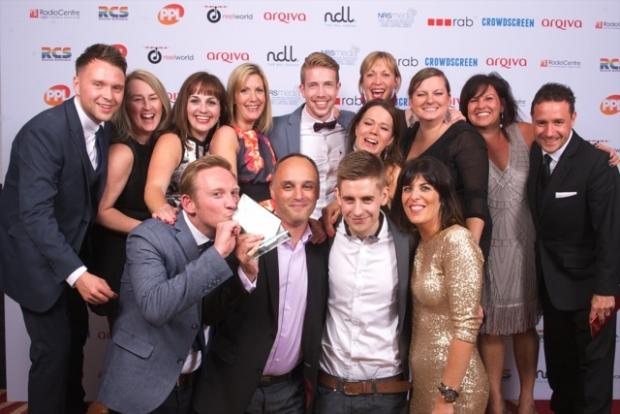 Worcester News: The Free Radio Herefordshire and Worcestershire team with their Station of the Year award at the Arqiva Commercial Radio Awards.
