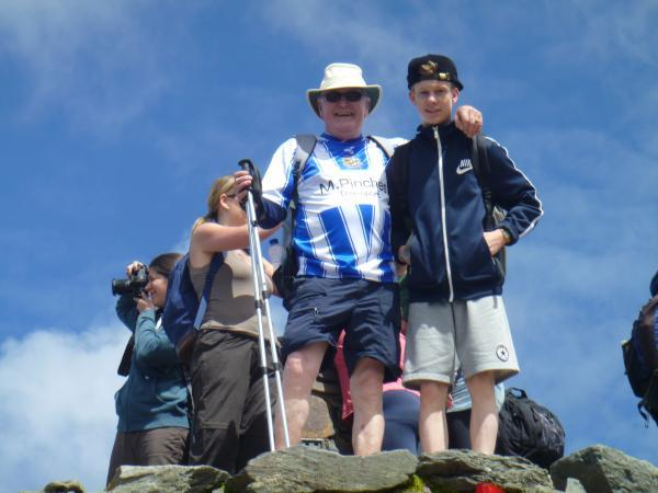 SCALING THE HEIGHTS: Worcester City director Mike Davis with Liam Wood at the top of Snowdon.