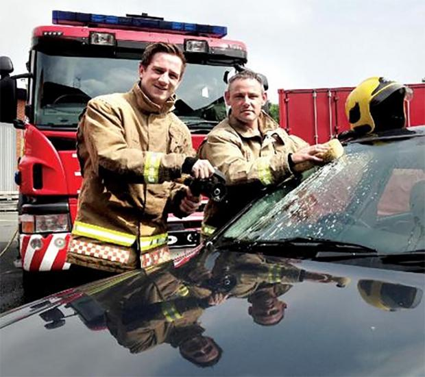 Firefighters Simon Beard and Gareth Taylor prepare for Saturday's car wash (s)