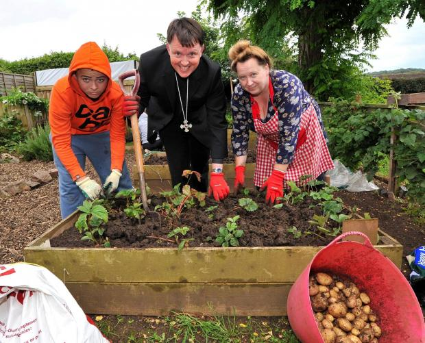 How does your garden grow? Bishop of Dudley, The Right Reverend Canon Graham Usher meets Bishop Perowne pupil, Dan Harding, aged 13, and Debbie Tett from Tolladine Church Mission. Picture by John Anyon 2814644101